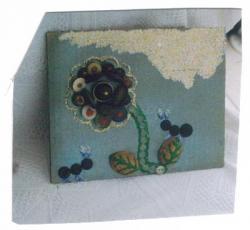 cadre-bouton-fleurs-vendu.jpg