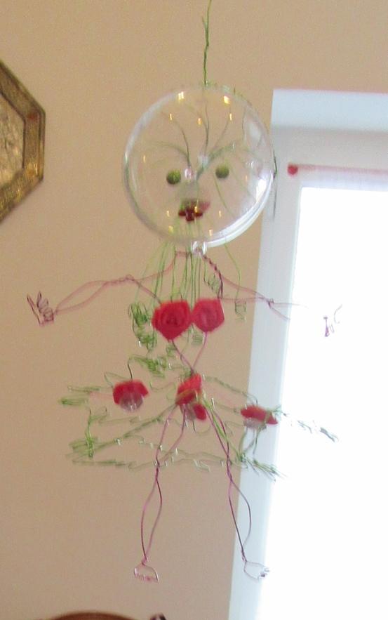 Poupee art a fleurs